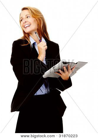 Businesswoman writing in her organizer diary while smiling and happy