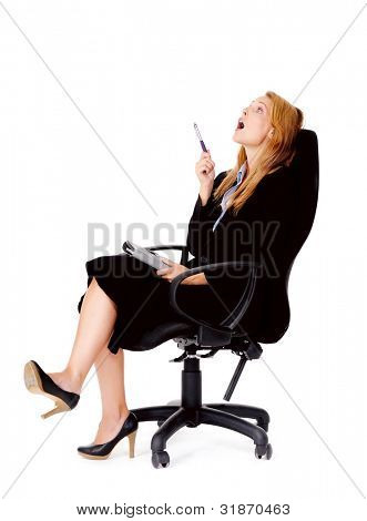 thoughtful businesswoman sitting in office chair has an idea