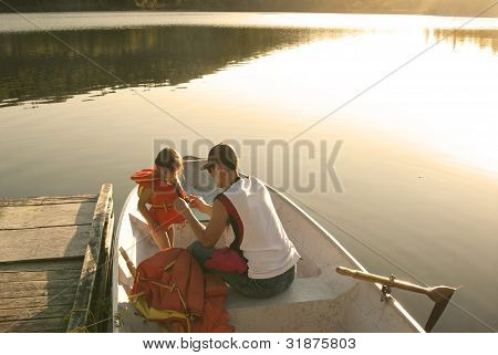 Daddy And His Little Girl in A Canoe