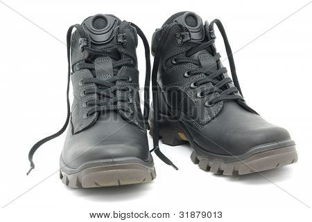 Black walking shoes isolated on white background.
