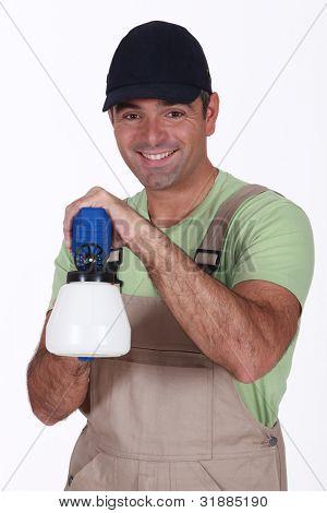 Man with spray gun