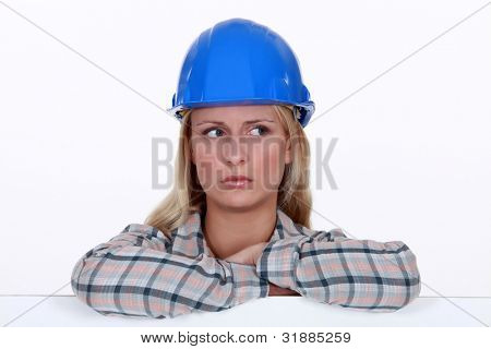 portrait of worried handywoman