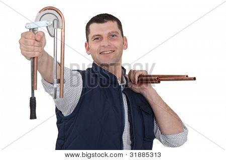 Plumber bending copper pipe