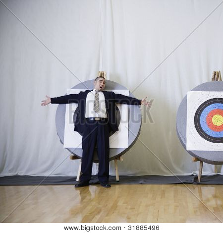 Kaufmann standing in front of Bulls eye