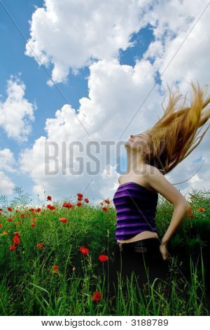 Girl With Beautiful Hair In Splendid Green Meadow