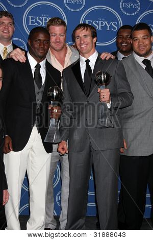 LOS ANGELES - JULY 14: Reggie Bush, Jeremy Shockey, Drew Brees along with members of the New Orleans Saints after winning the ESPY for Best Team - 2010 ESPY Awards on July 14, 2010 in Los Angeles, CA