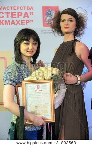 MOSCOW, - APRIL 01:The winner Alia Baymeshova on The XV Championship of Moscow on hairdressers art, decorative cosmetics, modeling and design of nails  on April 01, 2012 in Moscow.