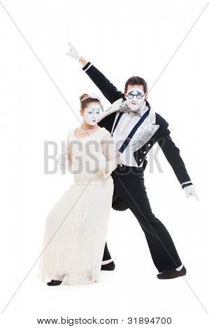 studio shot of funny dancing mimes. isolated on white