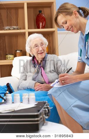 UK nurse visiting senior woman at home