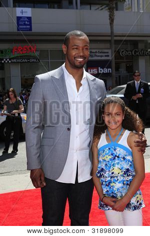 LOS ANGELES - APR 10:  Isaiah Mustafa arrives at