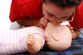stock photo of first aid  - Infant dummy first aid demonstration series  - JPG