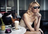 foto of spring break  - Calm blond beauty in a coffee shop - JPG