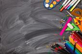 Stationery accessories on background of school blackboard. Top view, copy space. School accessories  poster