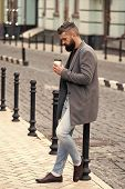 Walk And Enjoy Fresh Hot Coffee. Waiting For Someone In Street. Man Bearded Hipster Drink Coffee Pap poster