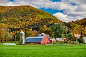 Farm with red barn and silos at sunny autumn day in West Arlington, Vermont, USA poster