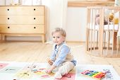 Little Boy. The Boy Plays With Wooden Toys And Numbers. Educational Wooden Toys For The Child. Portr poster