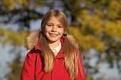 Fall Fashion. Kid Girl Wear Coat For Fall Season. Girl Smiling Face Cute Hairstyle Fashionable Fall  poster
