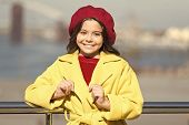 Girl Adorable Kid Walk Defocused Background. Kid Bright Hat Beret And Warm Coat. French Style Trend. poster
