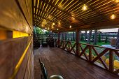 Interior Of Empty Hall Veranda In Wooden Village Vacation Home With Vintage Lamps And Chairs poster