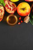 Rosh Hashanah Jewish New Year Holiday Concept. Traditional Symbol. Apples, Honey, Pomegranate. Copy  poster