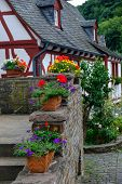 Flower Pots Arranged Nicely At The Beautiful And Picturesque Village Of Monreal In Eifel Region, Ger poster