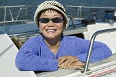 foto of early 50s  - Smiling Woman on Sailboat - JPG