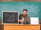 Teacher Or School Principal Welcomes With Blackboard Inscription Back To School. Beginning Of New Sc poster