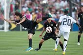 PASADENA, CA. - MAY 25: Mexico M Andres Guardado #18 (L) & United States F Freddy Adu #20 (R) during