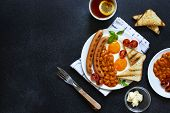 English Breakfast With Fried Sausages, Beans, Mushrooms, Fried Eggs, Grilled Cherry Tomatoes. Served poster