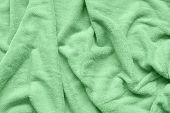 Trendy Soft Mint Colored Fabric With Waves And Folds. Soft Textile Texture. Folds On The Soft Fabric poster