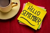 Hello September - handwriting on a sticky note with a cup of coffee poster