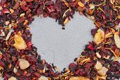 Heart Made Of Dried Hibiscus Tea With Fruits. Red Dry Tea Forming Shape Of Heart On Gray Background. poster