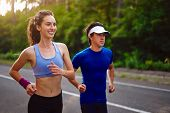 Fitness Sport Couple Running Jogging Outside Asphalt Road Pine Forest Nature Landscape. Runners Trai poster
