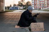A Man, Homeless, A Man Asks For Alms On The Street With A Sign Will Work For Food. Concept Of A Home poster