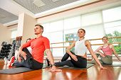 Fitness Group Does Exercises For Stretching Muscles In A Fitness Lesson. Group Fitness Concept, Grou poster
