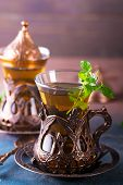 Traditional Turkish Tea With Mint Leaves In A Traditional Glass On Concrete Background poster