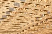 stock photo of 2x4  - Roof rafters in the new construction of a wooden building or house - JPG