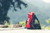 Hiking Backpack Travel Gear On Mountain. Items Include Hiking Boots, Cup, Map, Binoculars For Travel poster