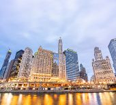 City of Chicago downtown and Chicago River sunset night in Chicago Illinois USA. poster