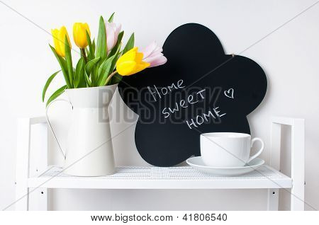 Home Interior Decoration: A Bouquet Of Tulips, A Cup And  A Chalk Board