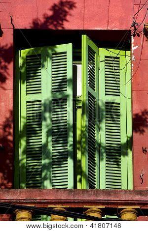 Old  Yellow Little Terrace Green Venetian Blind