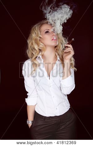 Sexy Woman With Cigar Exhaling Smoke On Dark Background