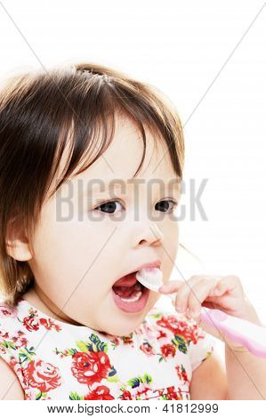 Child Brushes Teeth