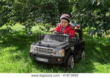 Boy Rides On Electric Car