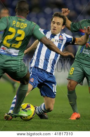 BARCELONA - FEB, 2: Joan Verdu of Espanyol in action during a Spanish League match between Espanyol and Levante at the Estadi Cornella on February 2, 2013 in Barcelona, Spain