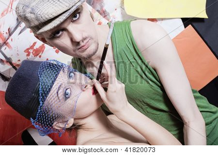 Studio Portrait Of Young Men And Women In Retro Style