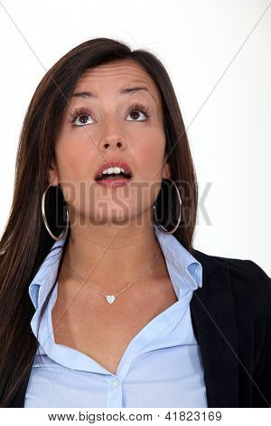 A surprised woman looking up at something