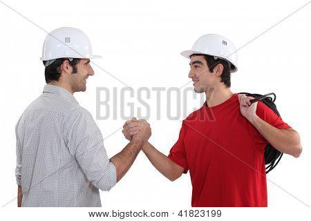 Tradesman welcoming a new recruit
