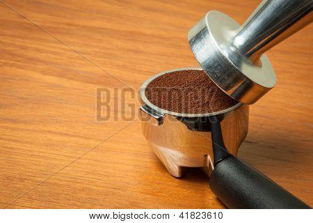 Portafilter on wooden table