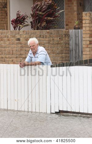 Brisbane, Australia - January 28 : Unidentified Resident Surveys Flood Damage From Ex Tropical Cyclo
